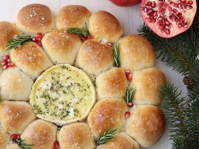 Brautiful bread wreath with camembert cheese dip in the middle