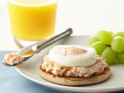 English muffin topped with salmon and egg
